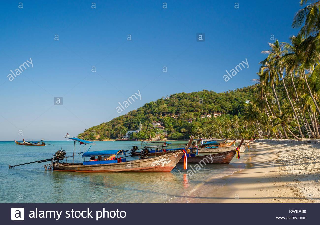 Long tail boats in Loh Bagao Bay - Koh Phi Phi Don - Thailand Stock Photo