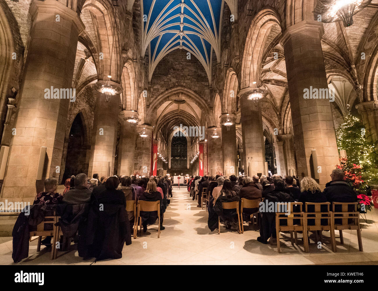 Interior of St Giles Cathedral during Christmas Carol Concert as part of Edinburgh's Hogmanay celebrations at - Stock Image