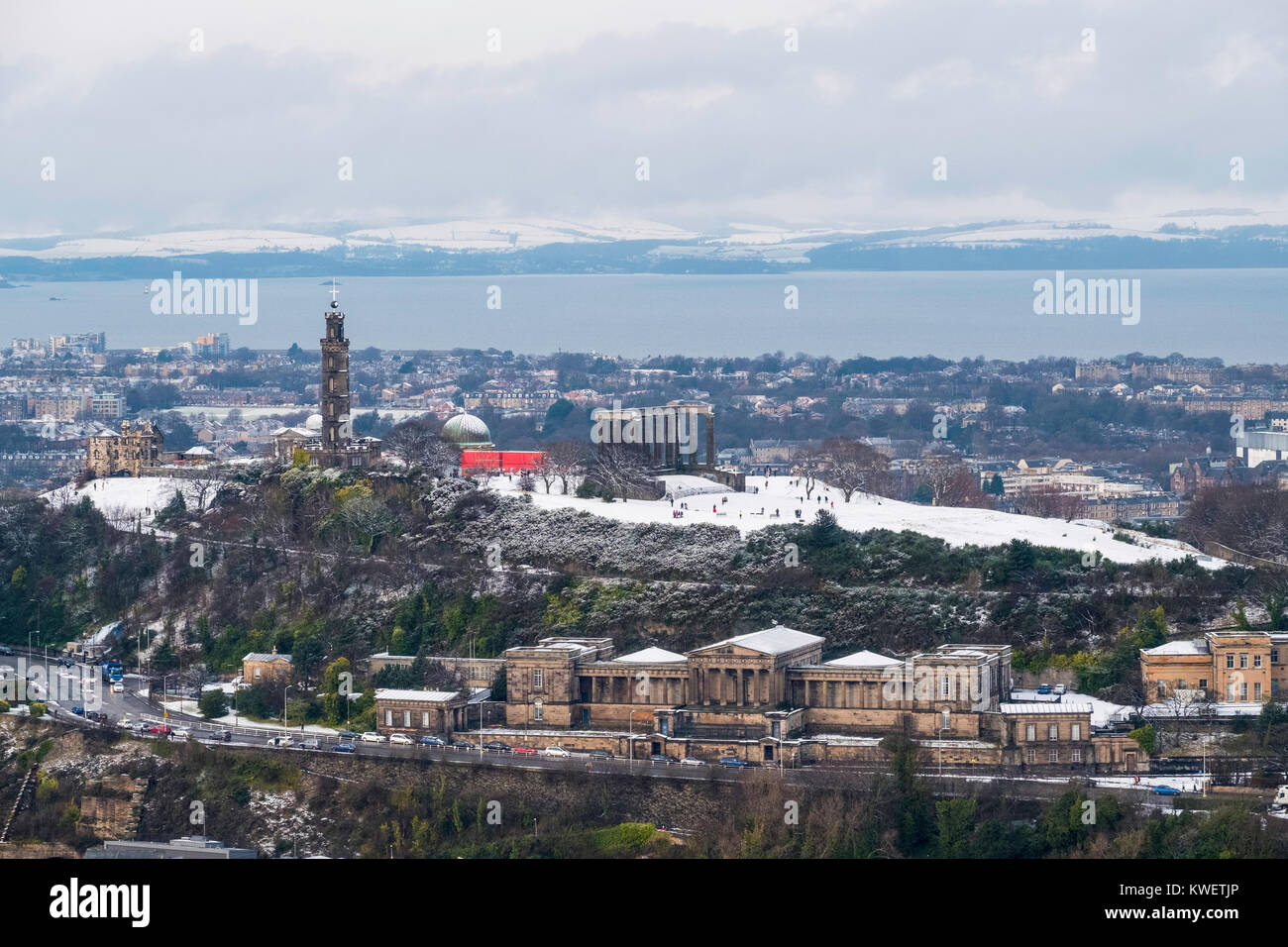 View towards Calton Hill and former Royal High School after snow fall in Edinburgh during winter in Scotland, United - Stock Image