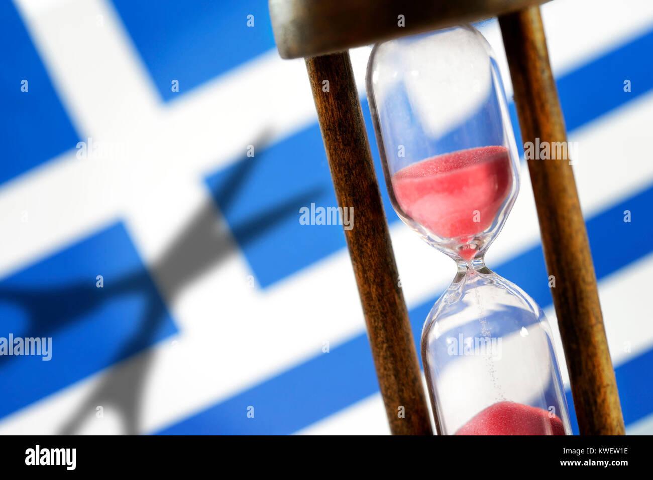 Greek flag, hourglass and shade of scissors, symbolic photo Greek debt cut, Griechische Fahne, Sanduhr und Schatten Stock Photo