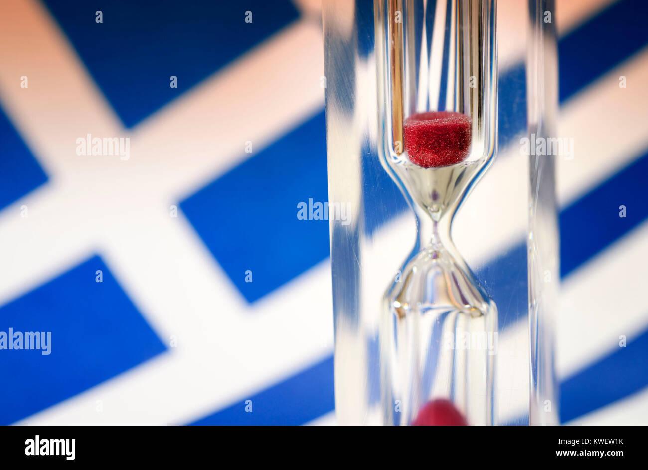 Greek flag and hourglass, symbolic photo Greek debt crisis, Griechische Fahne und Sanduhr, Symbolfoto griechische Stock Photo