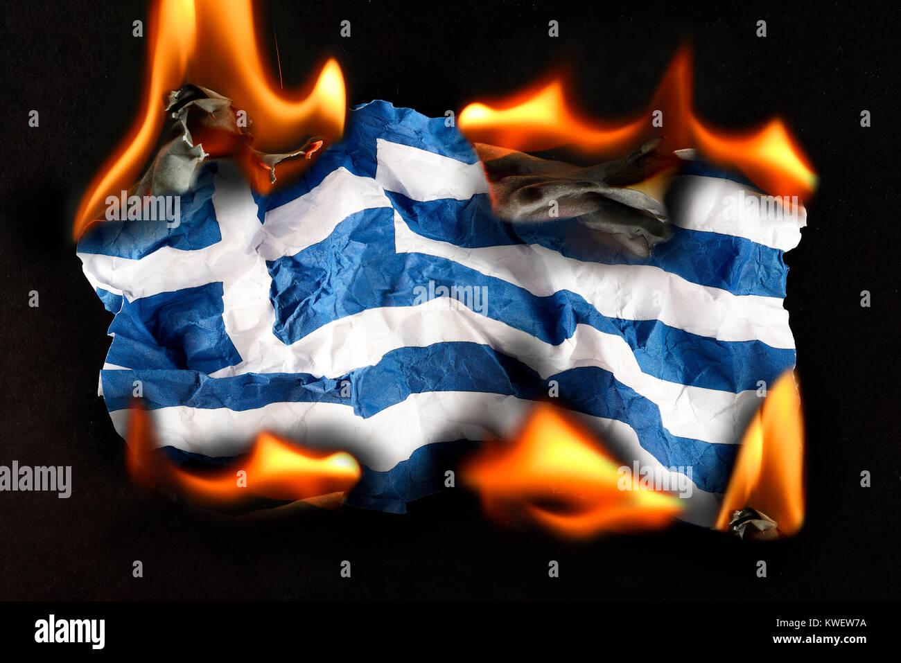 Greece flag in flames, symbolic photo debt quarrel, Griechenlandfahne in Flammen, Symbolfoto Schuldenstreit - Stock Image