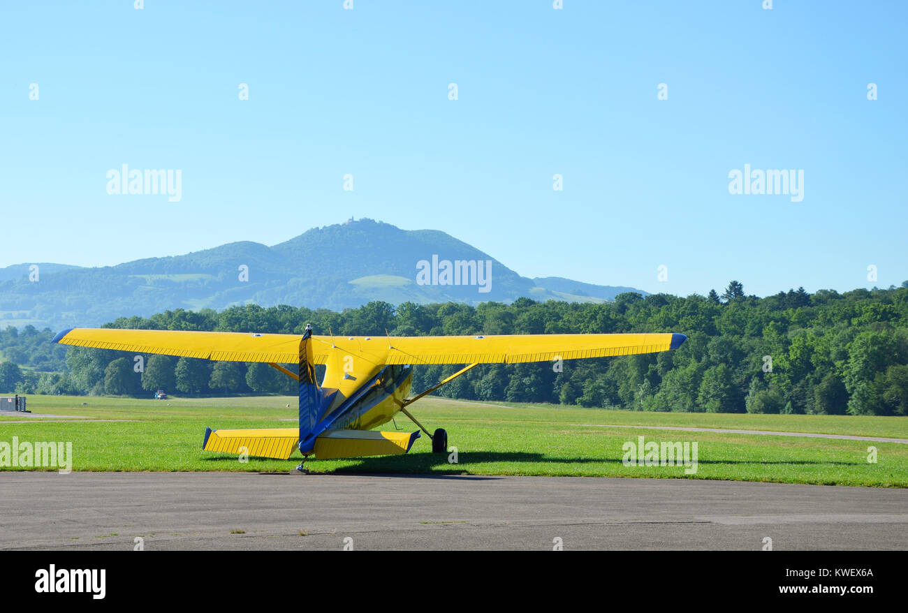 A small yellow plane ready for takeoff, seen at Hahnweide, Stuttgart, south Germany, June 2017 Stock Photo