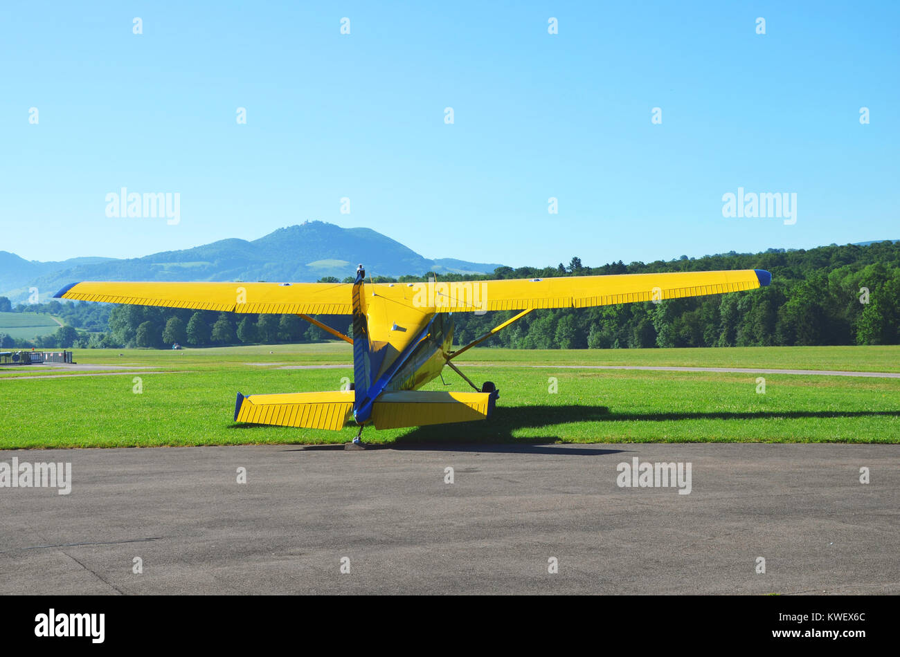 A small yellow plane ready for takeoff, seen at Hahnweide, Stuttgart, south Germany, June 2017 - Stock Image