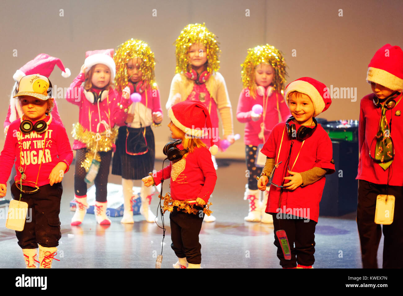 Three and four year olds singing and dancing, giving their christmas show Stock Photo