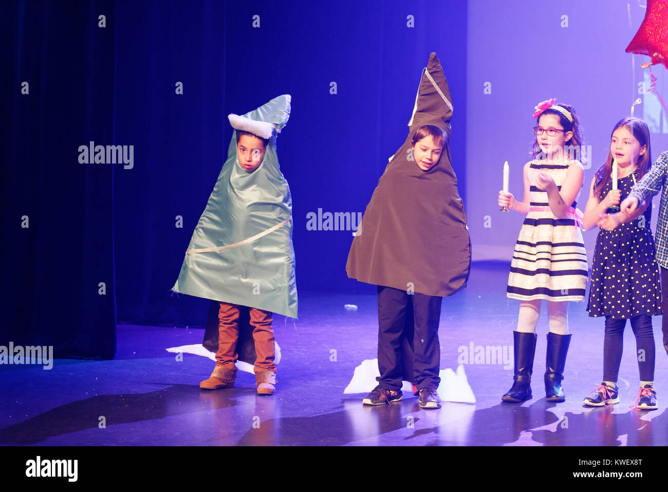Children dressed as pine trees during their christmas show Stock Photo