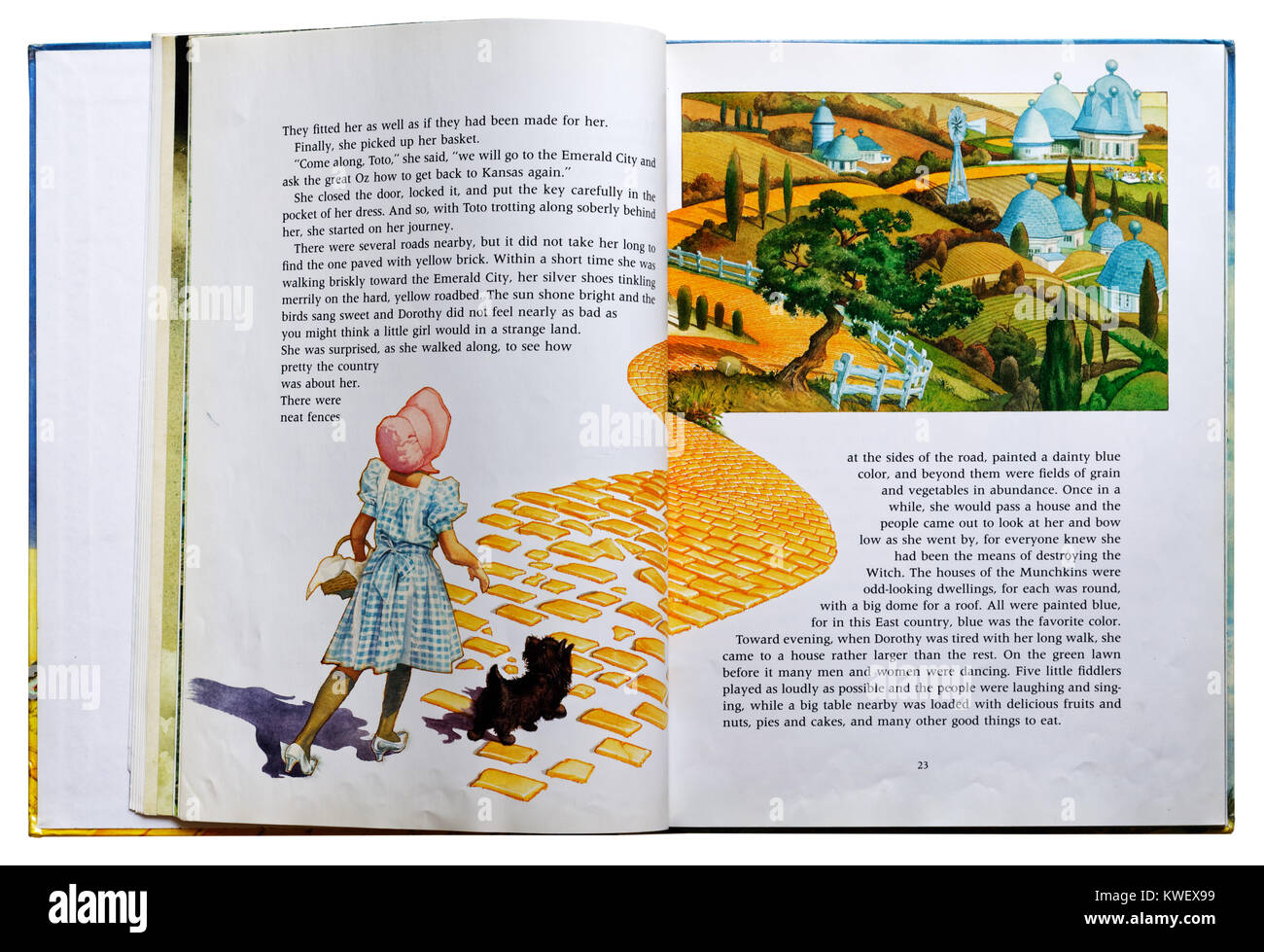 Dorothy on the Yellow Brick Road in an Illustrated book of The Wizard of Oz - Stock Image