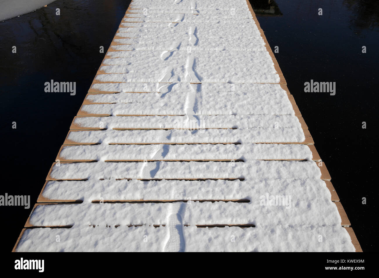 snow  with footstep tracks - Stock Image