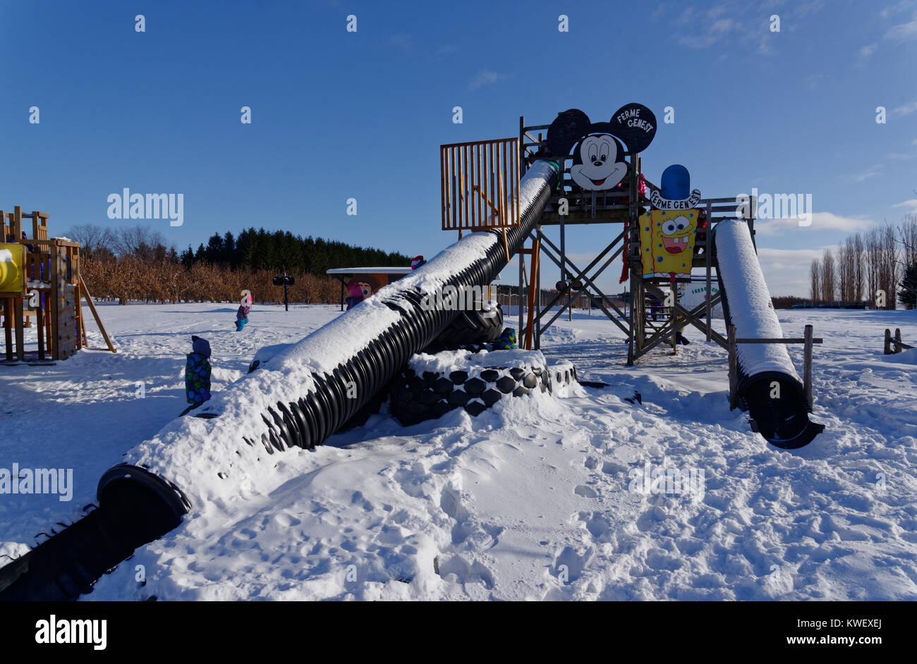 A slide in a playground in Quebec inwinter - Stock Image