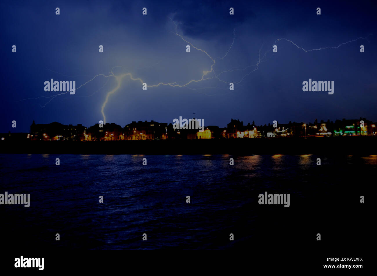 Thunder storm over the town of Deal on 18th July 2014, taken from Deal Pier at night... Stock Photo