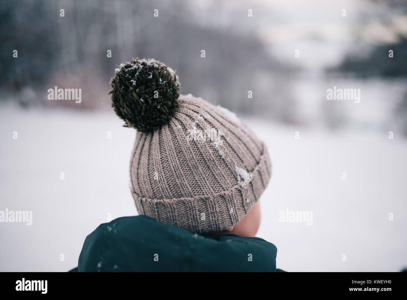 Close-up of little boy in winter time - Stock Image