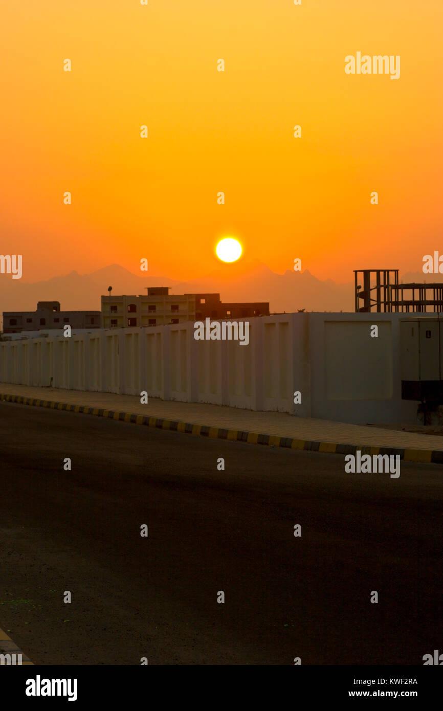 Sunset abowe construction in Egypt, Al Ghardaqah - Stock Image