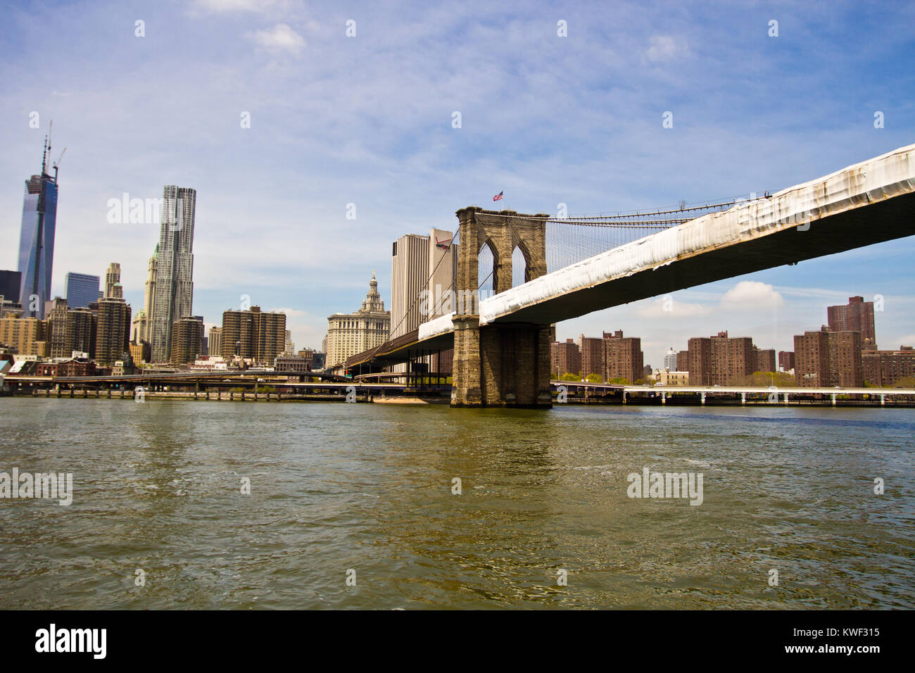 The Brooklyn Bridge is a hybrid cable-stayed/suspension bridge in New York City and is one of the oldest roadway - Stock Image