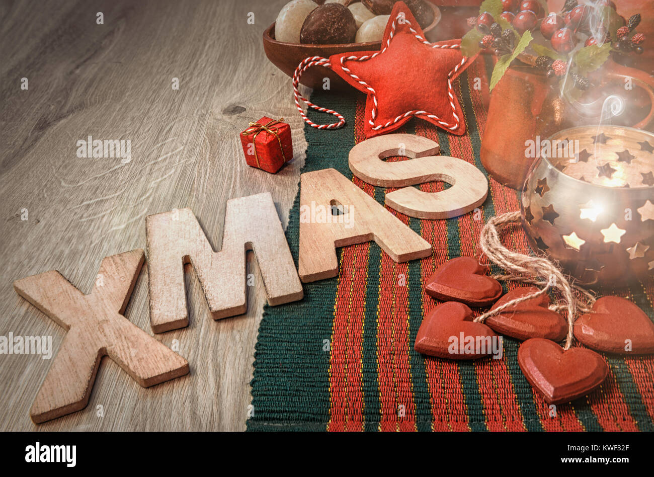 Xmas Wooden Letters And Christmas Decorations On Wood In Red And