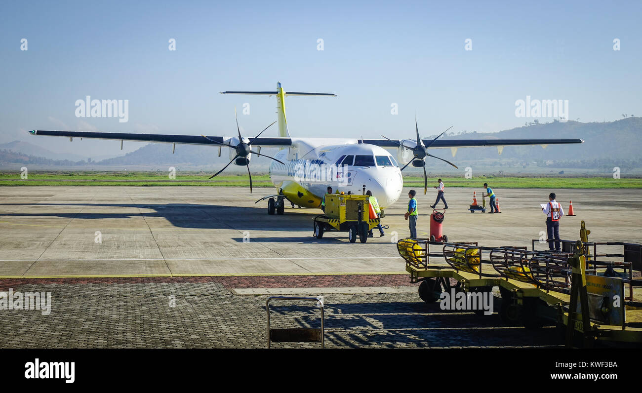 Coron, Philippines - Apr 12, 2017. A civil aircraft at Francisco B. Reyes Airport in Coron Island. It is an airport - Stock Image
