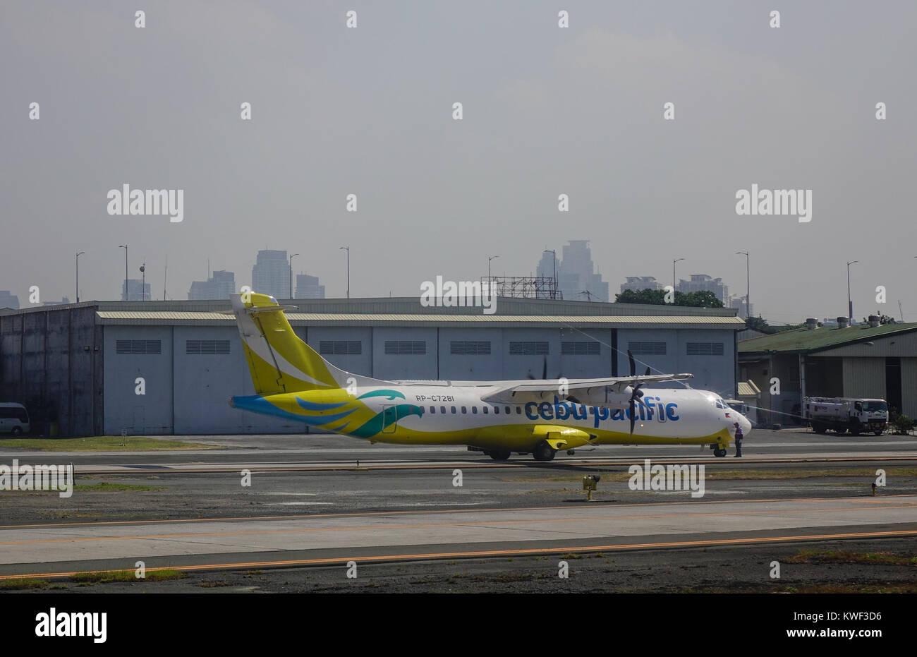 Manila, Philippines - Apr 12, 2017. A civil aircraft on runway at Ninoy Aquino Airport (NAIA) in Manila, Philippines. - Stock Image