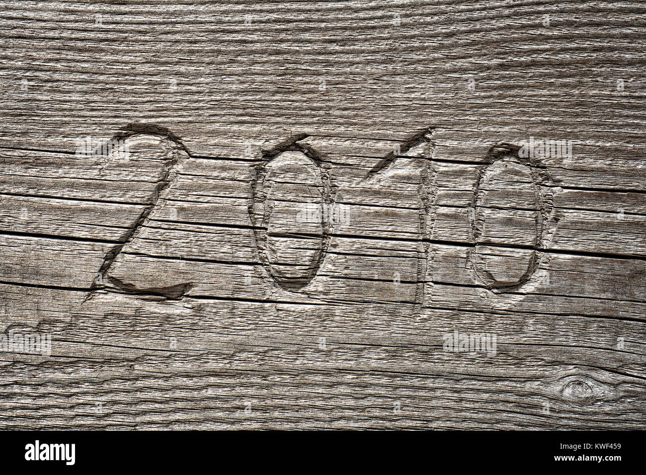 year number 2010 carved into wood stock image
