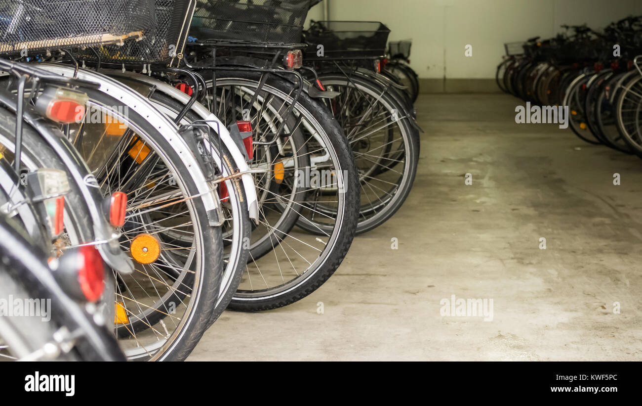Many parked bicycles in a garage - Stock Image