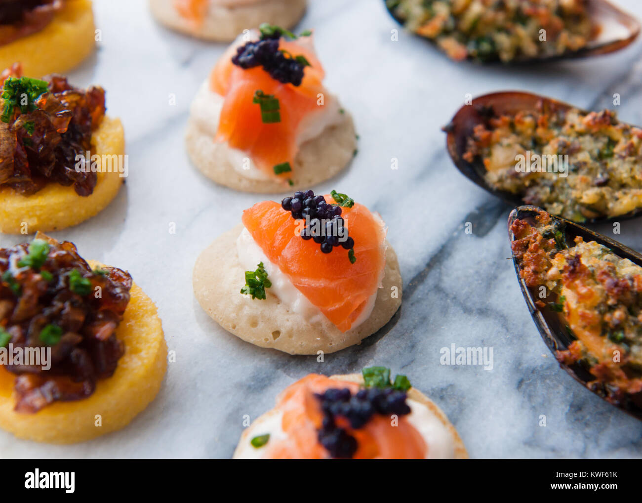 canapes on grey vein marble - Stock Image