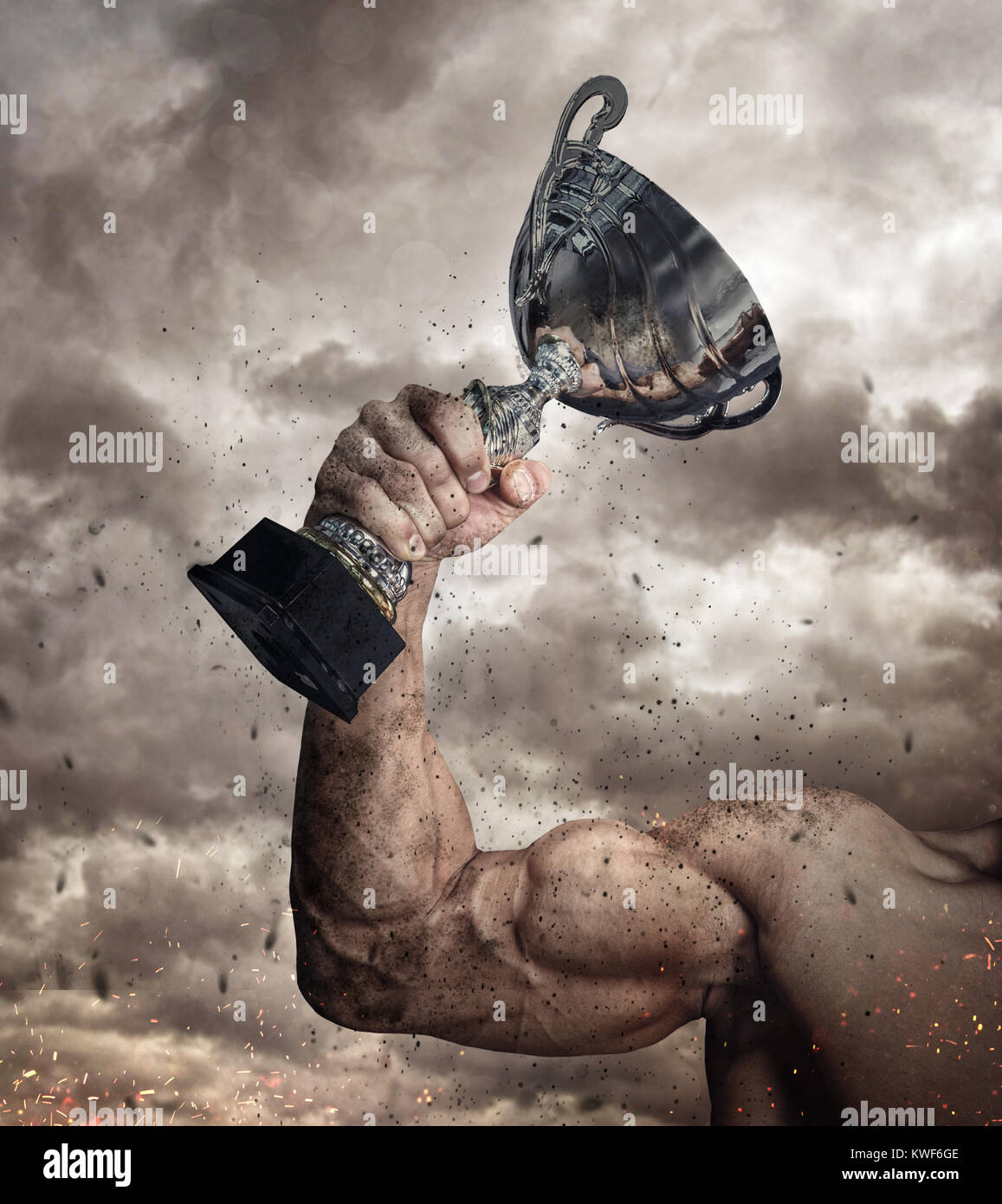 Cropped male arm with winner cup. - Stock Image