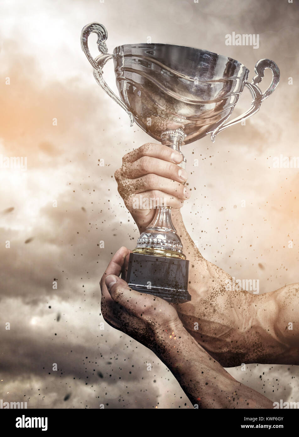 Cropped male arms with winner cup. - Stock Image