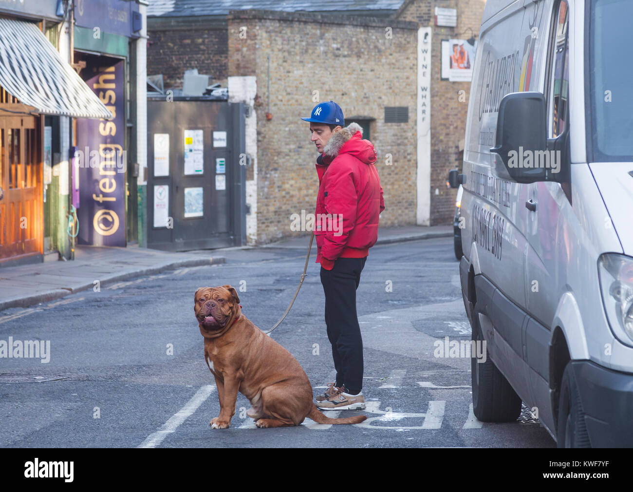 London, Borough of Southwark  One man and his dog in a street adjoining Borough Market - Stock Image