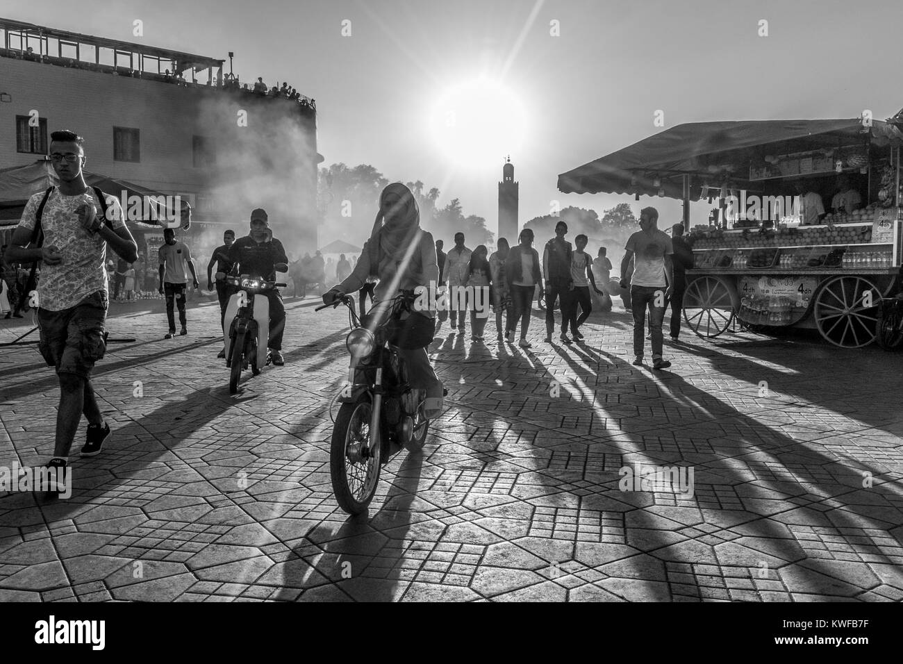 Street scene with people and dramatic light in Jemaa el Fna, The Square. - Stock Image