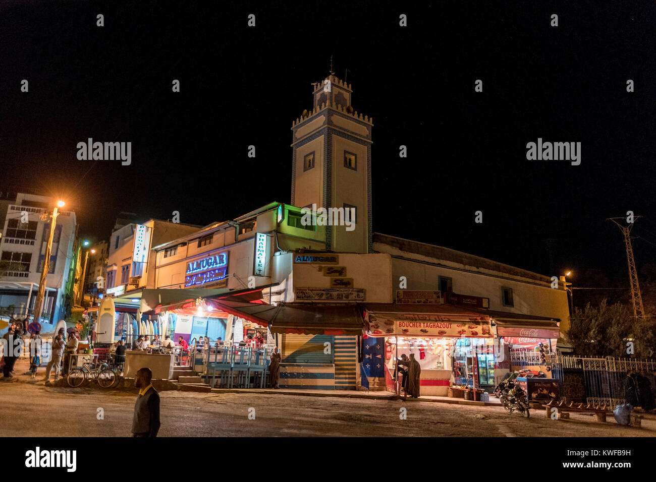 Night time and Mosque, cafe, pharmacy, butcher, gift shop all in one, Taghazout. - Stock Image