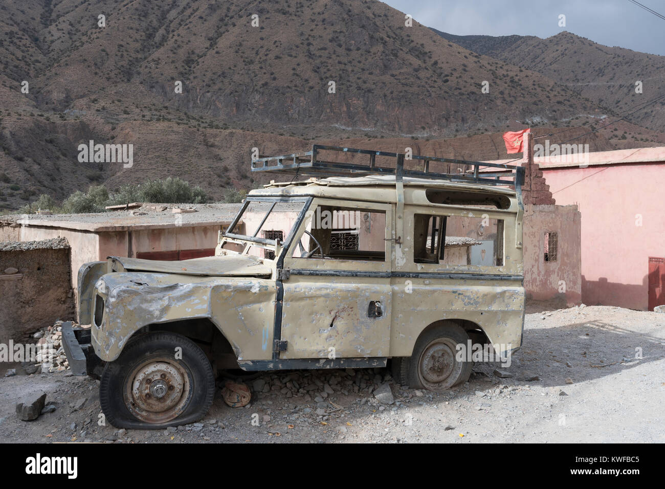 Abandoned Land Rover Defender given monument status on Tizi n Test, High Atlas mountain pass. Stock Photo