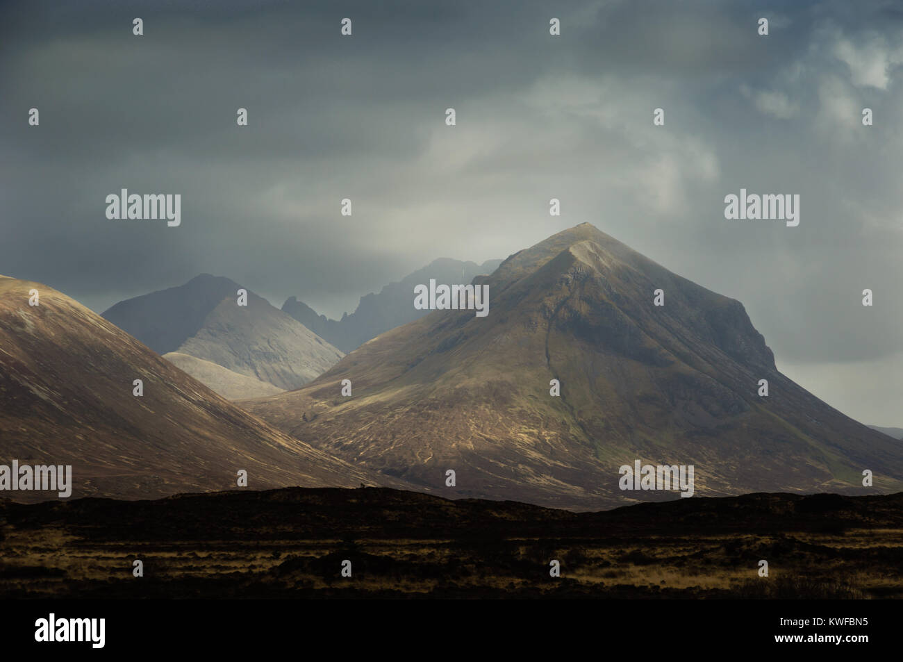 From very near Sligachan on the Isle of Skye, the peak of Marsco (right) is a prominent feature. This skyline will - Stock Image