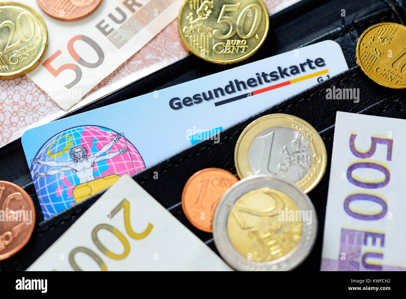Health map, monetary coins and bank notes, rise of the health insurance scheme contributions, Gesundheitskarte, - Stock Image