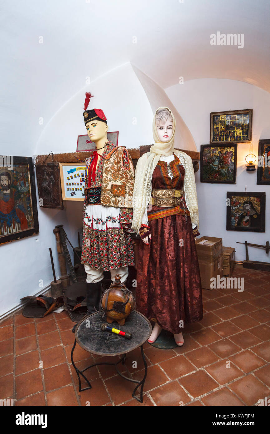 Models in local costume, First Romanian School Museum, Schei district, Brasov, a city in the central Transylvania - Stock Image