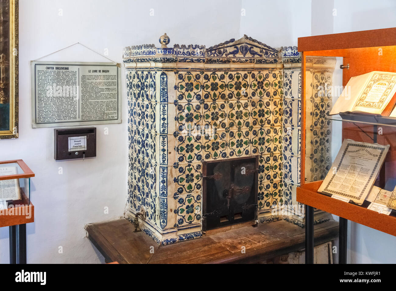 Old-fashioned ceramic stove heater in the First Romanian School Museum, Schei district, Brasov, a city in the central - Stock Image