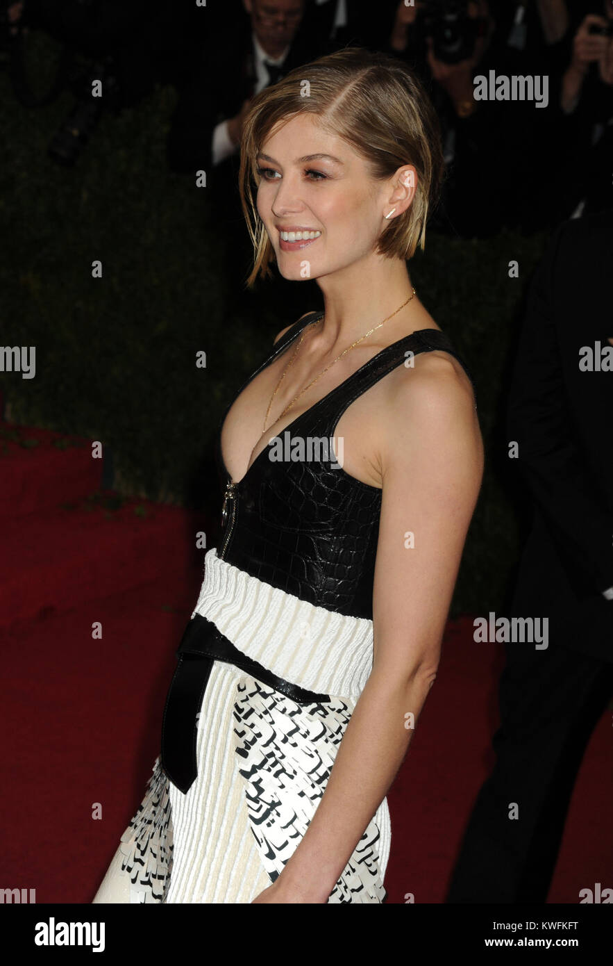NEW YORK, NY - MAY 05:  Rosamund Pike attends the 'Charles James: Beyond Fashion' Costume Institute Gala - Stock Image