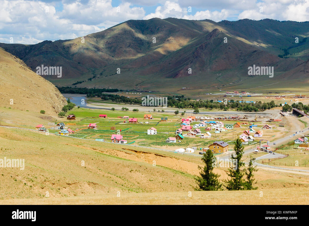 Mongolian countryside  landscape with small colorful, countryside settlement in valley outside the capital Ulaanbaatar, - Stock Image