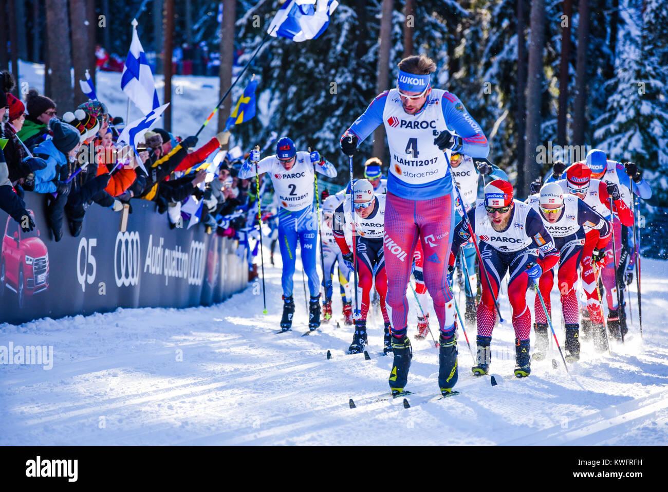 Russia's Sergey Ustiugov leads 30-k skiathlon (classic leg), Nordic World Ski Championships, Lahti, Finland, - Stock Image