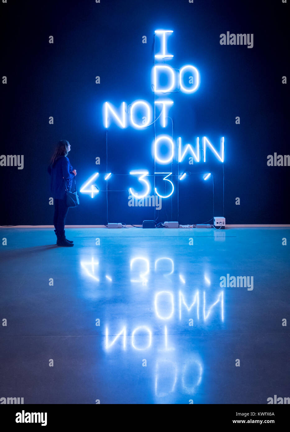 A young woman looks at the neon installation I Do Not Own 4' 33' by artist Pierre Huyghe, at the Remai Modern - Stock Image