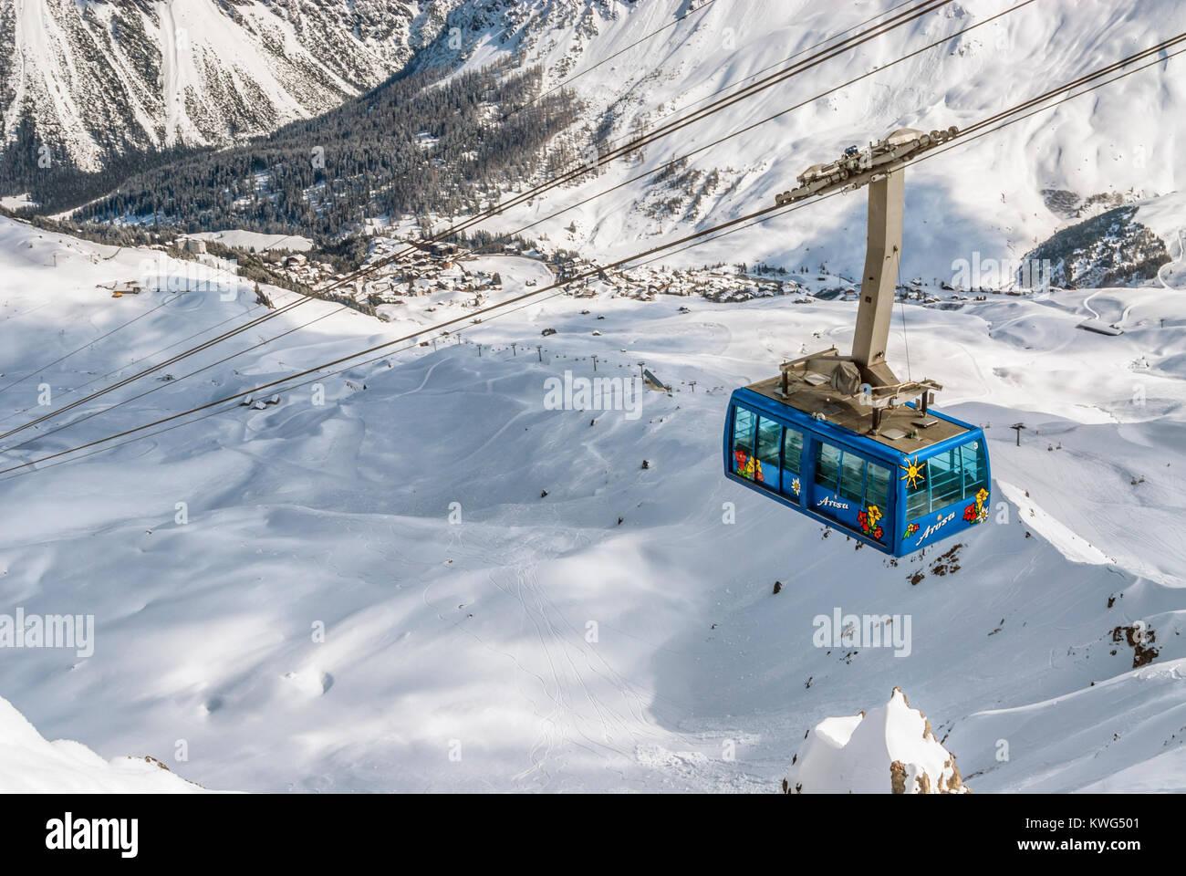 Arosa cablecar up to Weisshorn Peak at ski resort Arosa in winter, Switzerland - Stock Image