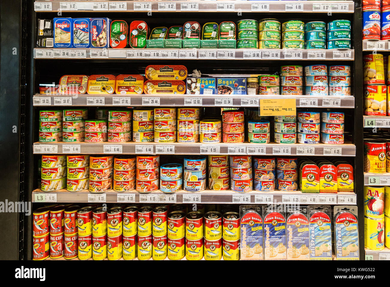 KUALA LUMPUR, MALAYSIA - DECEMBER 22, 2017: Canned tuna and other fish are displayed in a supermarket shelf in Malaysia Stock Photo