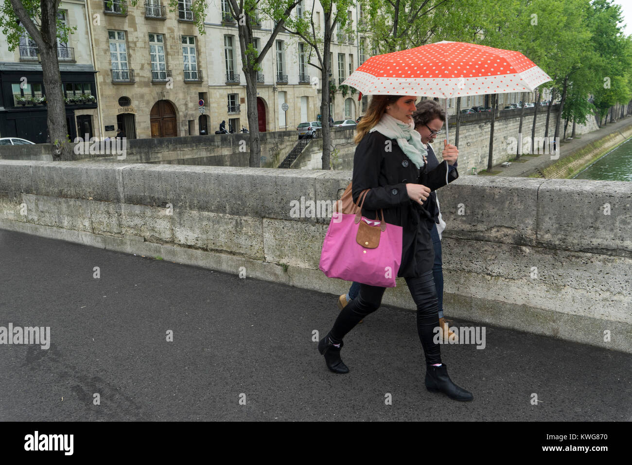 France, Paris, Walking across Pont Marie from Ile Saint Louis - Stock Image