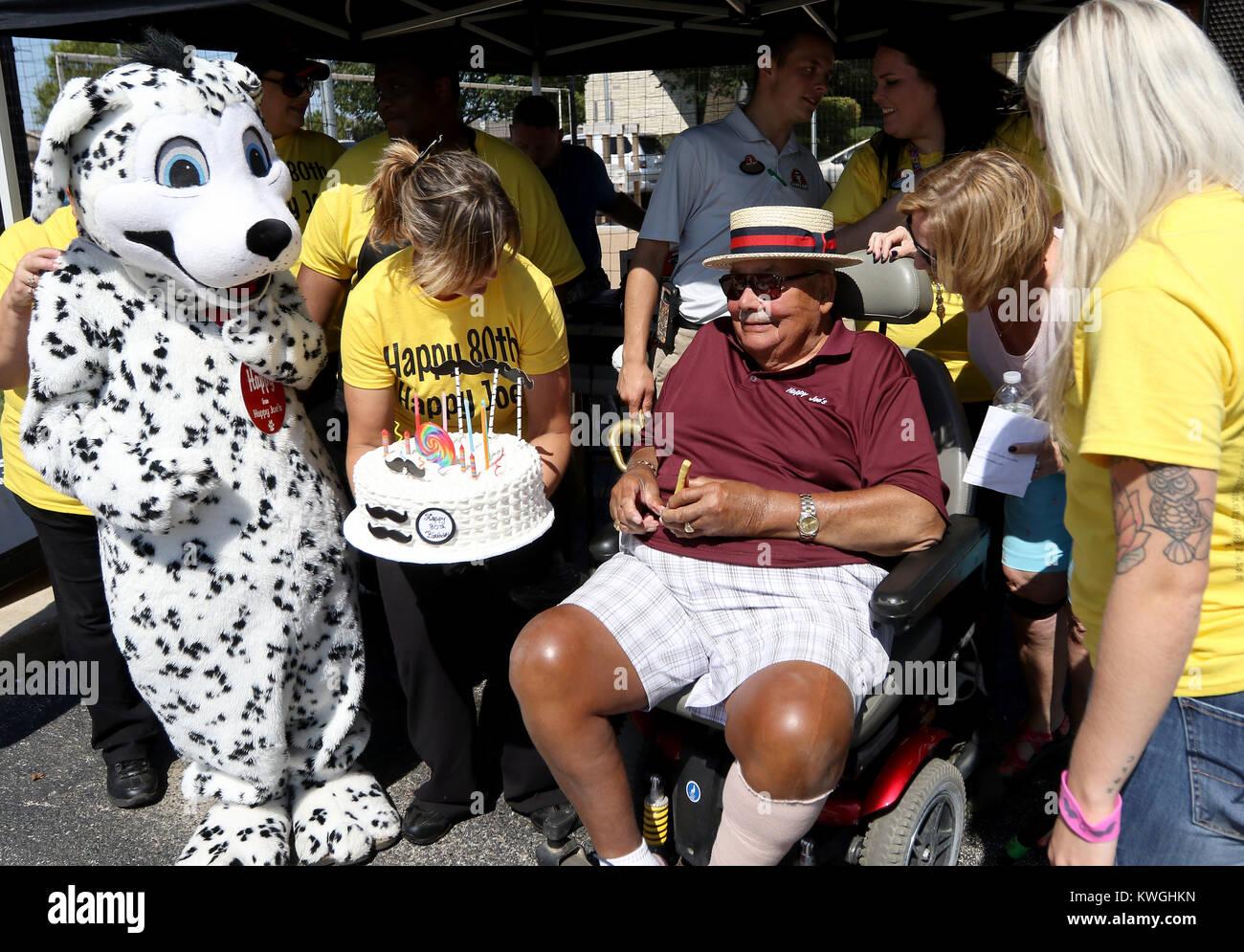 Eldridge, Iowa, USA. 10th Sep, 2017. Happy Joe Whitty, founder of Happy Joe's Pizza, is presented a cake, Sunday, - Stock Image