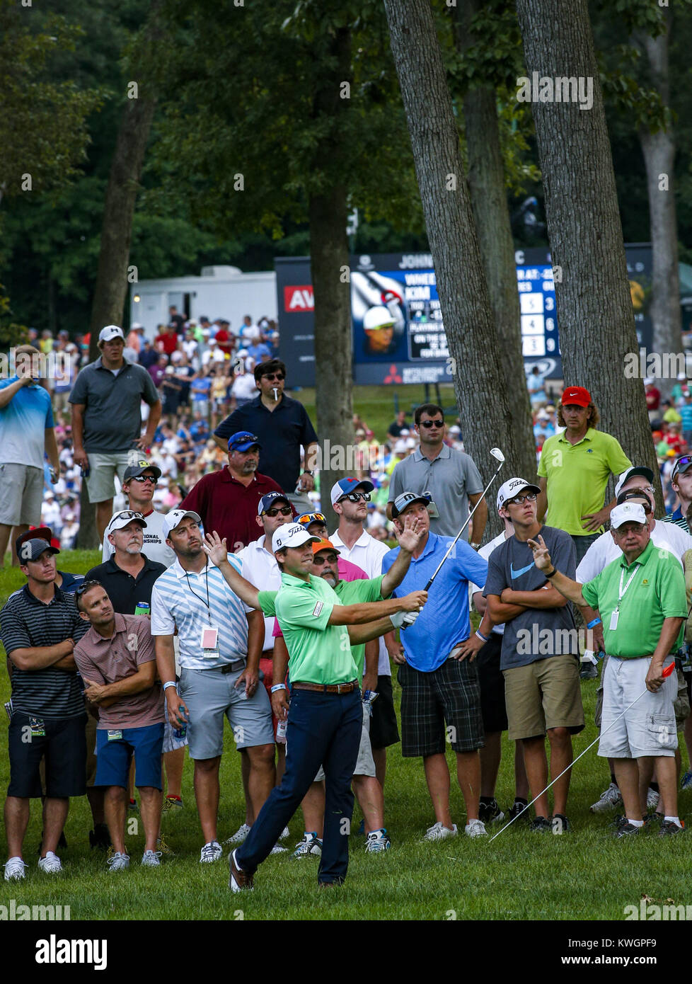 Davenport, Iowa, USA. 14th Aug, 2016. Professional Golfer Ben Martin watches his ball after hitting from the rough - Stock Image