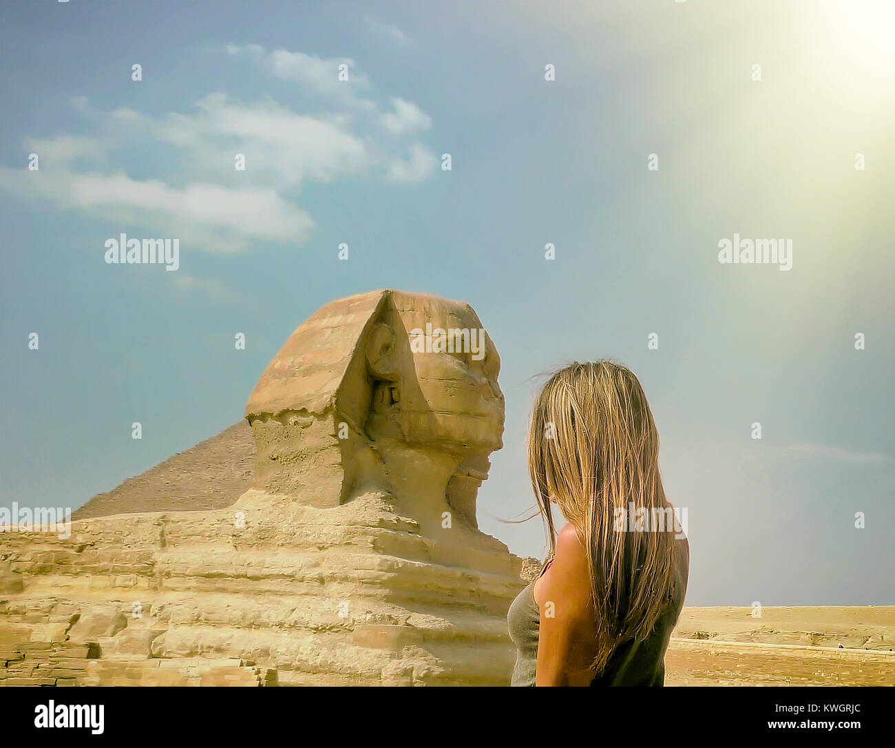 Woman standing in front of The Great Sphinx Of Giza in Cairo Egypt. Stock Photo. - Stock Image