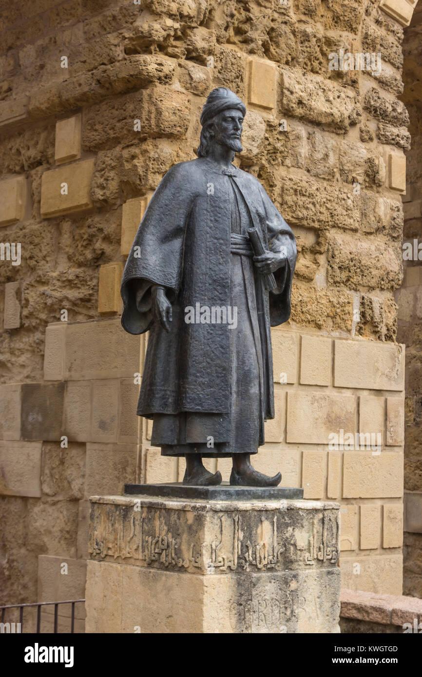 Puerta de Sevilla, Cordoba, Spain.  Statue of Ibn Hazm, Abū Muḥammad ʿAlī ibn Aḥmad ibn Saʿīd ibn Ḥazm, aka al-Andalusī - Stock Image