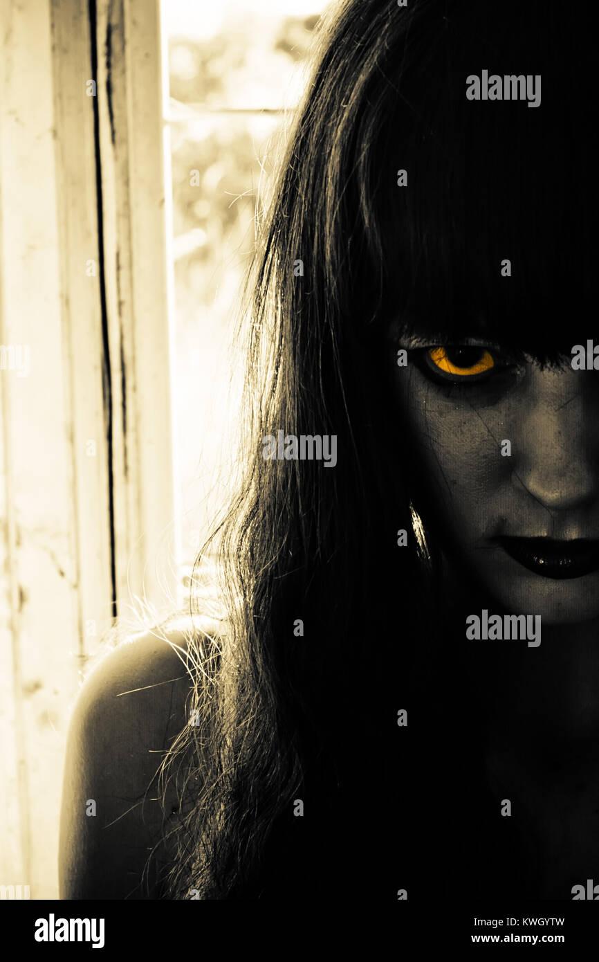 Dark and Suspenseful Woman - Stock Image
