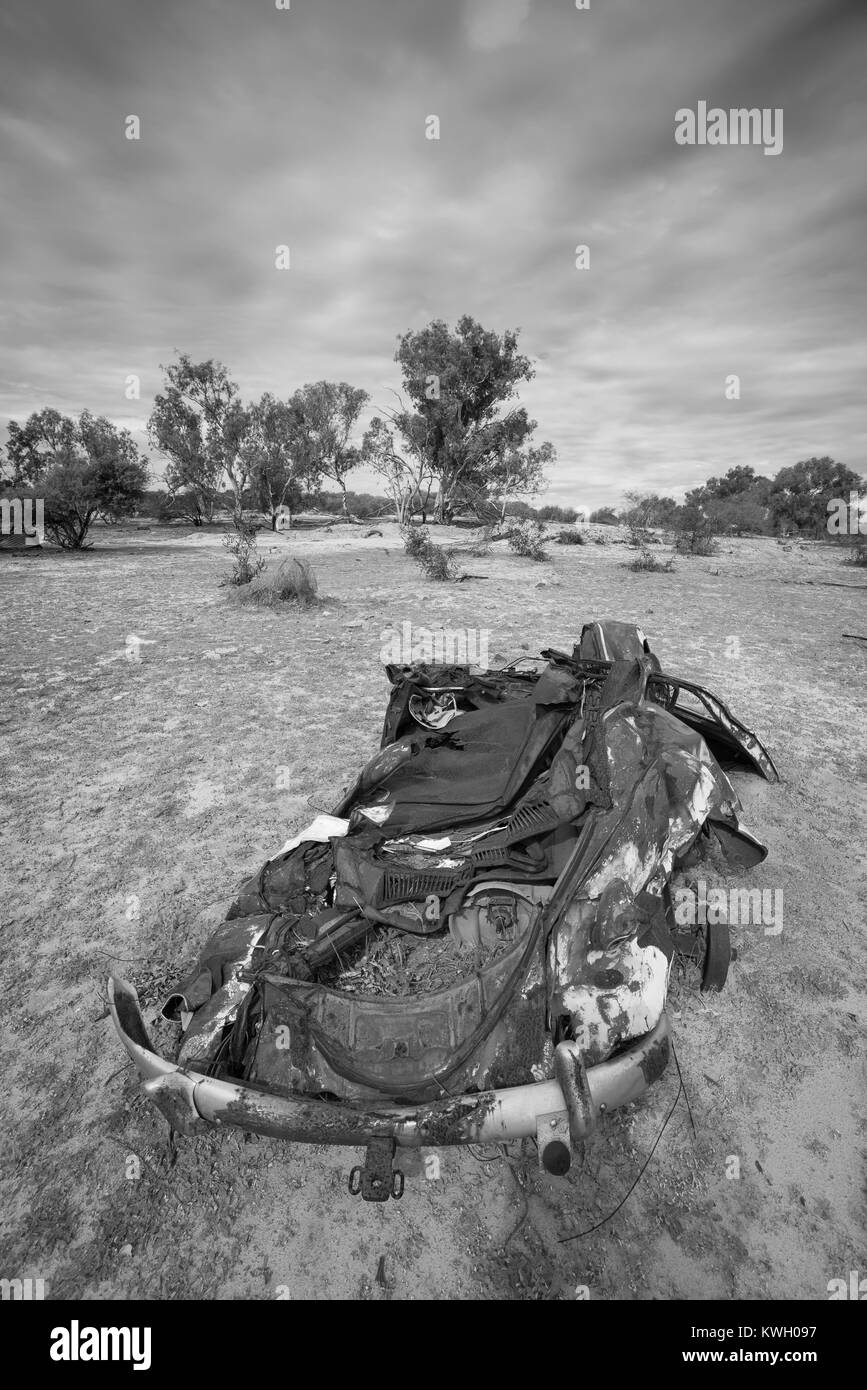 Flattened wreck of VW Beetle abandoned in outback australia - Stock Image