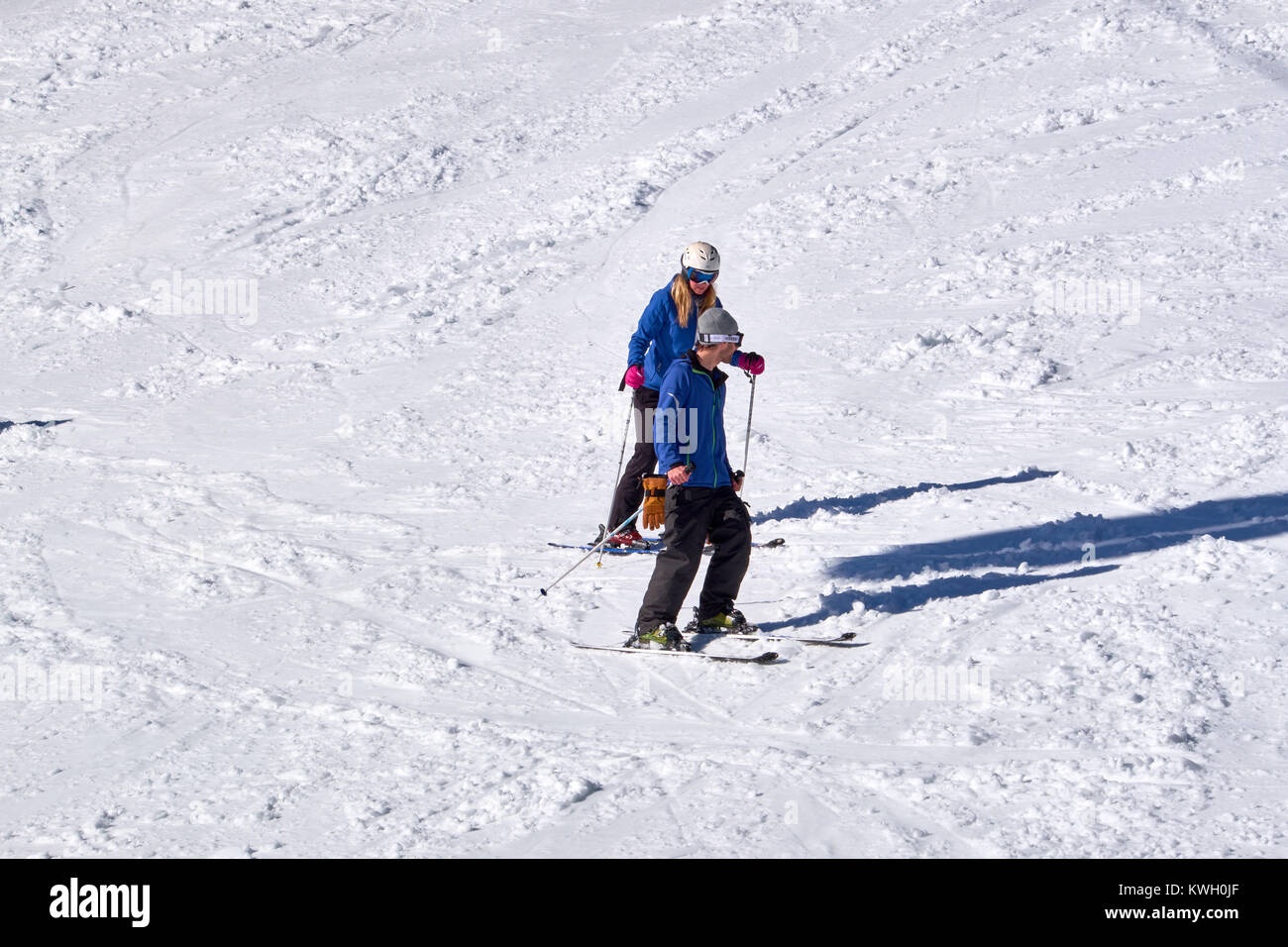 WINTERBERG, GERMANY - FEBRUARY 15, 2017: A young couple on slalom skies on a piste at Ski Carousel Winterberg - Stock Image