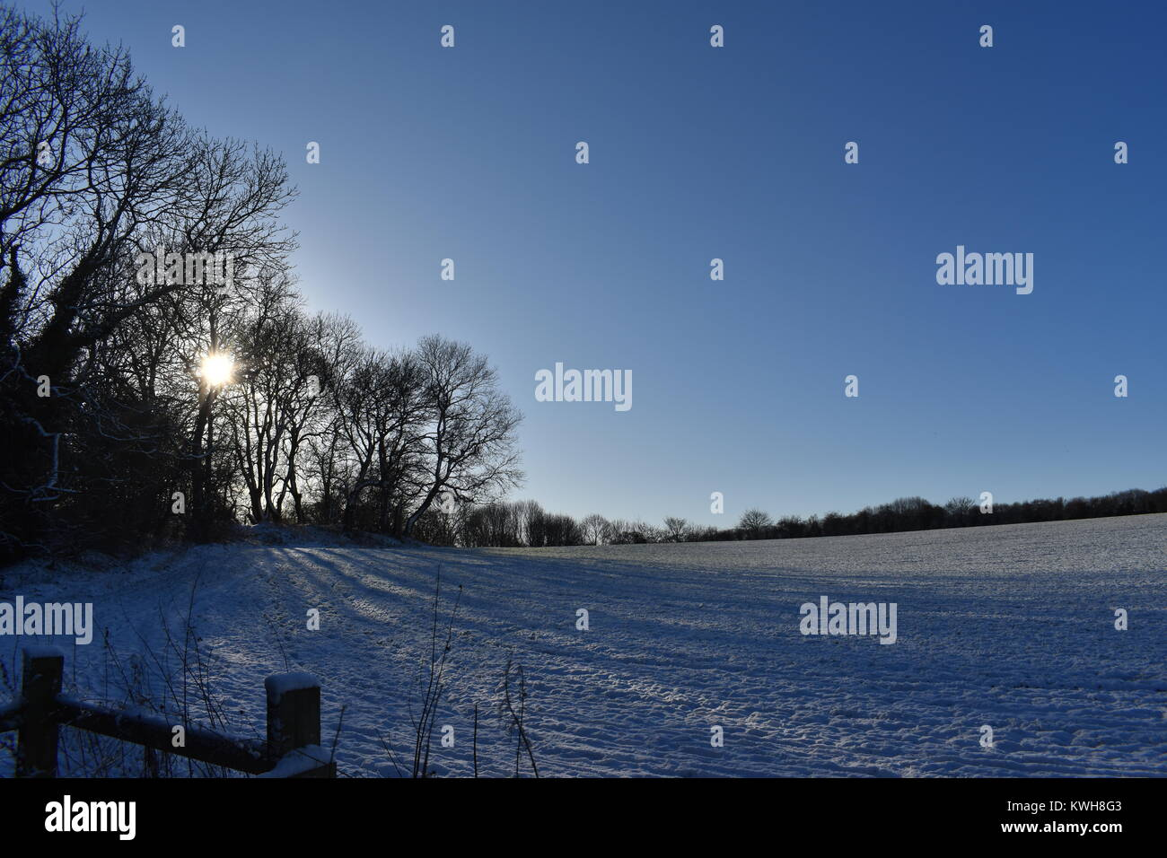 Shadows covering snow field - Stock Image