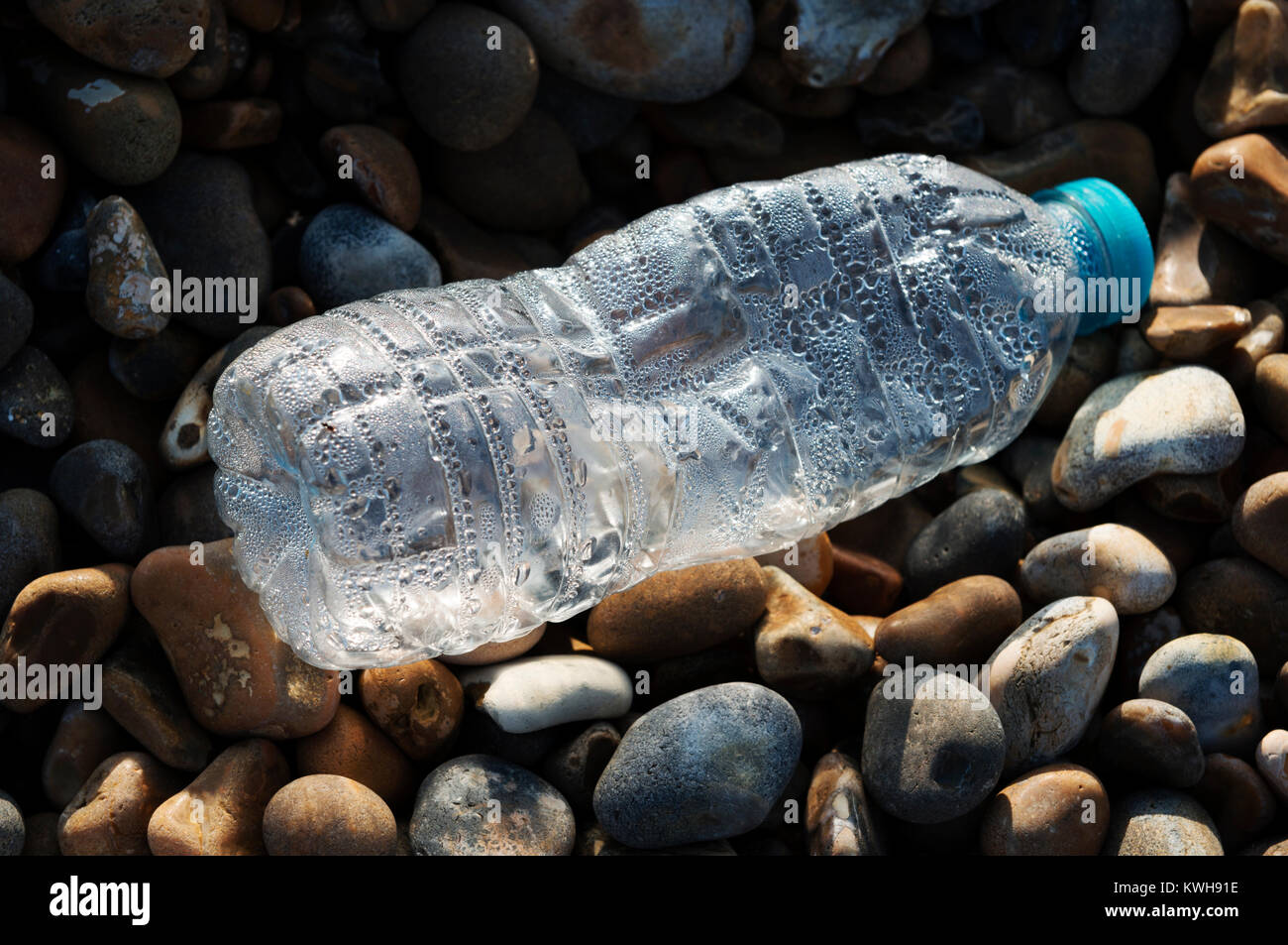 Plastic bottle washed up on a beach - Stock Image