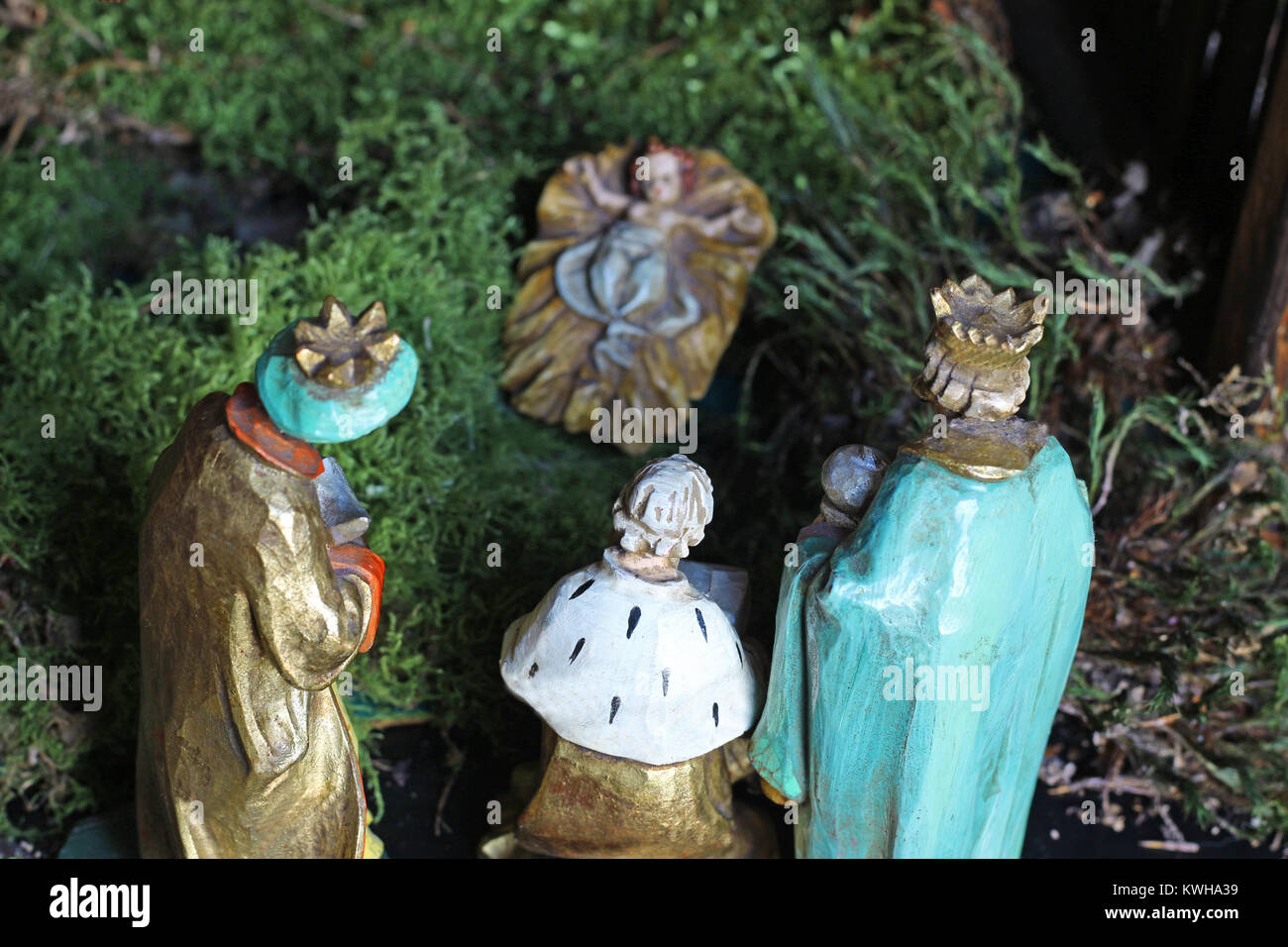 the three holy kings are bringing gifts to the new born child Jesus, rear view of the figurines, close-up - Stock Image